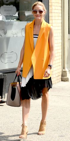 Olivia Palermo gave her pretty pleated black-and-white Zara dress a playful-yet-polished spin with a citrus orange Paul & Joe waistcoat, complete with a two-toned Smythson tote, sunnies from her Westward Leaning collaboration, and suede lace-up Aquazzura booties.