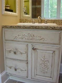 This is a picture of a vanity I updated 5 years ago. I added molding, painted, glazed with stain and distressed... So much better than the plain cabinet that was there! Glad someone found a picture to pin!