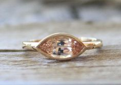 Peach Champagne Marquise Cut Sapphire Bezel Ring in 14K Yellow Gold by Studio1040 on Etsy https://www.etsy.com/listing/207530664/peach-champagne-marquise-cut-sapphire