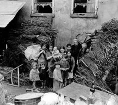 All these children and these women out of their makeshift shelter in Saint-Lô July 26, 1944.