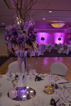 Purple floral tall centrepieces. Styled by Greenstone Events.