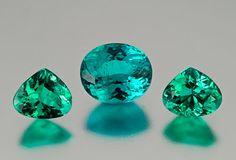 Brazilian Paraiba. Blue green center oval, 2.8 carats, 9.22 x 7.8 x 5.57 mm, and the green teardrop pair, 2.51 carats, 7.5 x 6.3 x 4 mm. (Photo: Mia Dixon)
