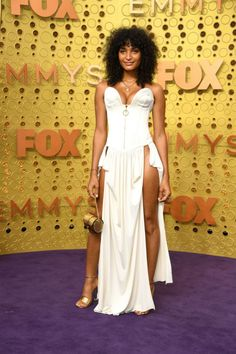 The Cast of Pose Turns the Emmys Into Their Own Personal Runway Padma Lakshmi, Christian Siriano, Christian Louboutin, Isla Fisher, The Emmys, Mandy Moore, Catherine Zeta Jones, Kristen Bell, Michelle Williams