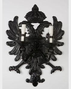 A monumental shield sconce in beaten iron from the du Pont estate. This one of a kind sconce is available from Remains Lighting Los Angeles.