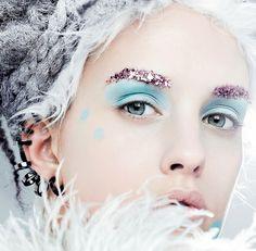 Pastel blue lids, pink glitter brows.