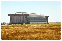Tustin CA: one of  two mastodon blimp hangers, built in 1942 to house blimps. In 1949, blimp operations were phased out  by the Santa Ana NAS—as it was called. Each hangar is more than 1,000 ft long & 300 ft wide. In 1999, one of the blimp hangars was designated a national historic landmark & is to be preserved (the 2nd one presumably will be torn down).   It's estimated that if the 2x4's used in each hangar were place in linear fashion, the line would extend from San Diego to Sacramento!