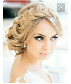 Beautiful crown braid with soft touches, very lovely.