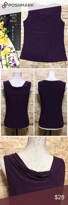 """Susan Lawrence Drape-neck Blouse Dark Purple / Plum Sleeveless Blouse has the perfect drapey neckline. Hits just below hips. Fitted style with tons of stretch. One minor flaw: the seam at the bottom is missing a few stitches (see last photo for closeup of seam) but it doesn't hang down or affect the appearance at all, and hasn't come unraveled in the wash. Machine washable.   Measurements lying flat: • Bust: 16.5"""" across armpit to armpit plus tons of stretch ability  • Length: 22.75"""" Susan…"""