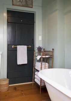 brass towel bar on back of door--Lonny