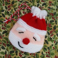 Best 12 This happy Santa goody bag will keep small gifts secret. He is very easy to make with a drawstring hat which when opened will reveal all the festive treats inside. Use him in place of a traditional stocking, hang him on the Christmas tree or place Christmas Bags, Christmas Crafts, Christmas Decorations, Christmas Tree, Father Christmas, Xmas, Christmas Knitting Patterns, Crochet Patterns, Cascade Yarn