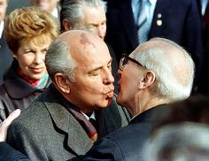 Soviet Leader Mikhail Gorbachev and his wife, Raisa, are welcomed by East German Leader Erich Honecker (R) with a kiss in East Berlin, celebrating the 40th anniversary of East Berlin, October 6, 1989. (Reuters)