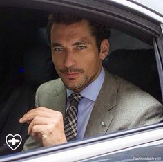 David Gandy on Day One, London Collections: Men SS '15.  Suit: Welsh and Jeffries Savile Row, shirt: Marks and Spencer, tie: Tom Ford, shoes: John Lobb, watch: Omega. June 15, 2014. Source unknown.