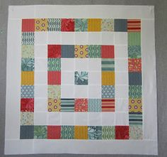 This one has some general sizes.  It would appear that the layout after it has been cut, looses approximately 30%.  Layout of Merry-Go-Round Twister Quilt