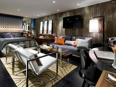 What #teen doesn't love gadgets? Designer Candice Olson creates a hip pad full of electronics and music for this lucky teen. Recycled black leather flooring, a distressed-metal paint treatment and customized artwork turn this basement into a cool #hangout and #bedroom retreat.