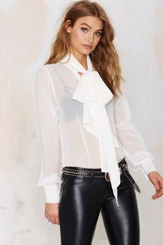 The Nasty Gal Marianne Pussy Bow Blouse mixes sheer and classy together with style.