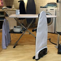 Rowenta's Collapsible Ironing Board ($299), out in June, unfolds in three simple steps. Its convenient size (45 inches tall when closed and 54 inches when extended) is perfect for urbanites or anyone without a spacious laundry room. #ihhs13 #rowenta #laundry