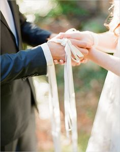 Scottish wedding tradition: The Scottish like to tie the knot in a literal way. The couple participates in a hand-fasting ceremony where their wrists are bound together by a cloth or string. PC: Chris Isham