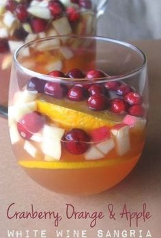 Cranberry, Orange & Apple White Wine Sangria | Dry Riesling sweetened with raw honey, then mixed with 100% tart cranberry juice, brandy and popular fall fruits such as apple, orange and cranberry.  @therisingspoon Apple Sangria, White Wine Sangria, Sangria Recipes, Cocktail Recipes, Cocktails, Fall Fruits, Seasonal Fruits, Unsweetened Cranberry Juice, Apple Brandy