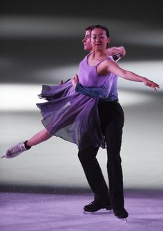 Mao Asada of Japan and Jeffrey Buttle of Canada perform their routine...