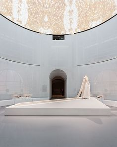 Met Spotlights Fashion and Technology in OMA-Designed Ghost Cathedral