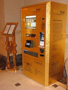 Gold to Go is a gold-plated vending machine that dispenses gold bars in various sizes and gold bullion coins. The first one was installed several years ago in the Emirates Palace Hotel in Abu Dhabi. Abu Dhabi, Cool Gadgets, Tech Gadgets, Gold Atm, Gold Bullion Bars, Bullion Coins, Dubai, Cool Technology, Inventions
