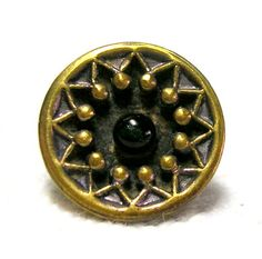 """THIS WONDERFUL OLD BRASS BUTTON HAS A LACY DESIGN AROUND THE INSIDE OF THE RIM AND FEATURES A TRANSPARENT EMERALD GREEN PIGEON'S EYE GLASS BALL RIGHT IN THE CENTER-IT MEASURES A HAIR OVER 9/16"""" IN DIAMETER WITH A JAPANNED TIN METAL BACK AND LOOP SHANK-IT IS GERMAN IN ORIGIN, CIRCA THE LATE 19th CENTURY PERIOD AND IN EXCELLENT CONDITION---"""
