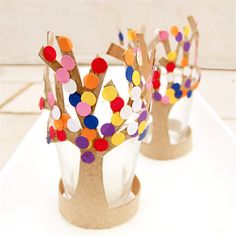 Anticipate Spring with these adorable tp tube trees in bloom, complete with hole punch blooms!