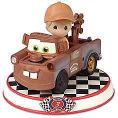 Tow Mater Figurine by Precious Moments - Cars   Disney Store Everyone's favorite tow truck shares a big smile in this third piece in a series of colorful Disney•Pixar's <i>Cars</i>-inspired collectible mini-figurines. You can always rely on Mater to give your spirits a lift.