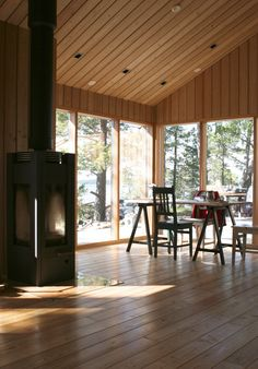 JOARC I ARCHITECTS • Holiday Villas • summerhouse interior, wood burning stove, takka, kesämökki, timber, scandinavian architecture