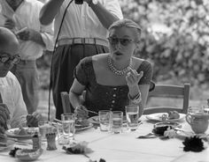 1952 Joan Fontaine eating at a restaurant in Torcello Island, Venice