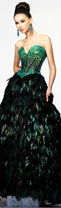 Sherri Hill - black feathers and green gown PROM!!!!❤️ http://weardownjacket.blogspot.com/  how pretty with this fashion CAOT! 2014 CANADA GOOSE JACKET discount for you! $169.99