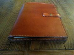 """Handstitched, Leather, closable portfolio/notebook/note pad holder. Fits 8.5 X 11"""" legal pad and spiral notebooks. Durrable veg tan leather by StevensLeather on Etsy https://www.etsy.com/listing/513509583/handstitched-leather-closable"""