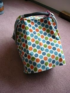 reversible carseat cover for Sally. This is a pretty easy tutorial to follow. I think they turned out well!