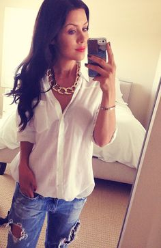 chunky chain necklace with a white button down and destroyed jeans