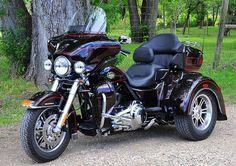 Harley Davidson Trike.  He's got the bike......but he wants it triked!