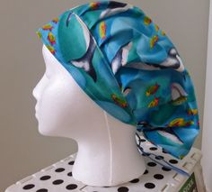 This is bouffant style of scrub hat. It has pleats in front and a drawstring with a toggle in the back making it possible to adjust the fit...