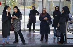 Women wait for a bus in central Tehran, Iran August 24, 2015. REUTERS/Darren Staples