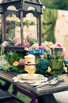 Pretty colored glass, flowers and centerpiece.