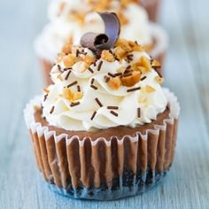 Nutella Cheesecake Cupcakes - Oreo crust, chocolaty Nutella cheesecake, with whipped cream and hazelnuts. Amazing.