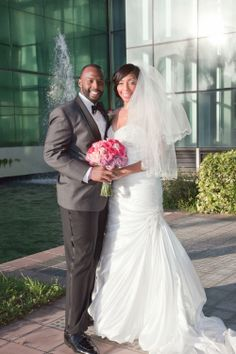 Jonelle and Patrick pictured on Pavilion Grille's out-door photo terrace with romantic fountains in the background.  Photo by Joel P. Black