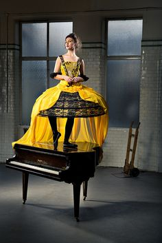 10.10.13 This image jumped out at me when I first saw. The balleria is so graceful and this cage-like structured dress almost represent an animalistic quality within the dancer. Also, the yellow of the wardrobe definitely standouts amongst the similarity of black within the accents of the wardrobe and piano.  Edinburgh College of Art Theatre costume designs