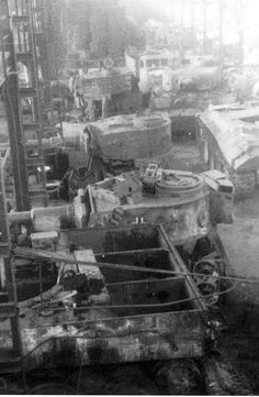 A factory that refurbishes damaged tanks like these Tiger 1 variants