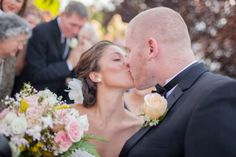 We love this big, happy smooch! Andrew Reiner Photography. #weddingphotography #bride #groom #kiss #snapknot