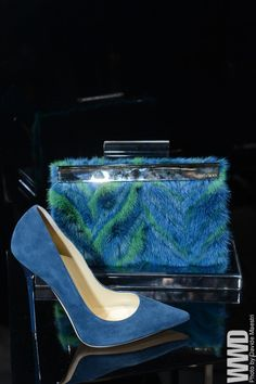 womensweardaily:      Jimmy Choo's blue mink herringbone clutch and sexy blue suede pumps added a touch of va-va-voom for fall.    Oh me oh my!!!!!    //