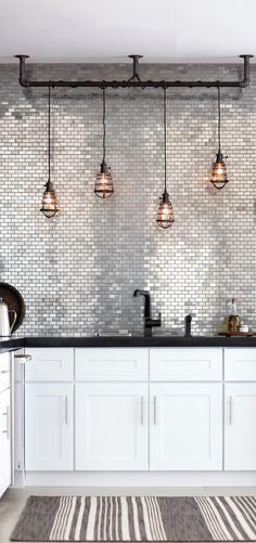 backsplash. tile. color silver. light fixture. black sink hardware.