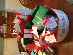 A basket with 12 activities for kids to do on the days leading up to Christmas. Each one is wrapped Leave one gift out each day starting on December 14! Activities include : Christmas puzzle, family game, homemade   ornaments, hot cocoa, cinnamon bun mix, polar express, Christmas movie, paper to write letters, pap... @Skye James Collings