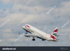 LONDON, UK - AUGUST, 2 2013; A British Airways Embraer ERJ-170STD (G-LCYE) take off at the London City Airport in the borough of Newham