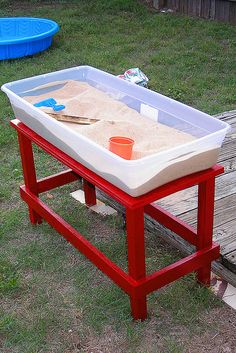 Sand table using a plastic bin, just put the top on when finished. This is a good idea... we have one of the cute turtle sand boxes but we had to stop using it because the cover doesn't seal tight, so ants, spiders and other bugs would still be able to crawl in with the cover on it.