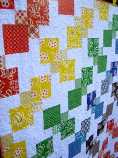 Close up of Rainbow Kite Quilt by kelbysews, via Flickr... just saw the block...big square in one corner with a little square diagonal to it filled with background to make the block.