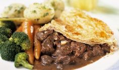 Hearty beef stew slow braised in a broth of dark ale topped with a puff pastry crust…yummy! - Tomato, Dinner, American, Pastry, Entrée, Beef, Winter, Egg, Fall, Puff Pastry, Thyme, Main, Pie/Tart